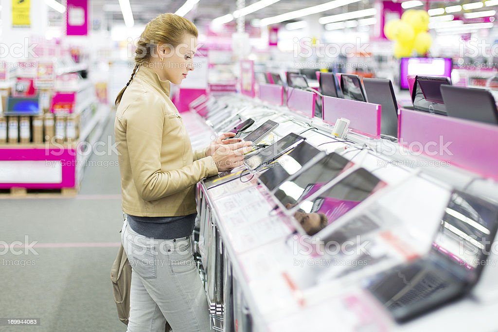 Woman buys a digital tablet at store stock photo