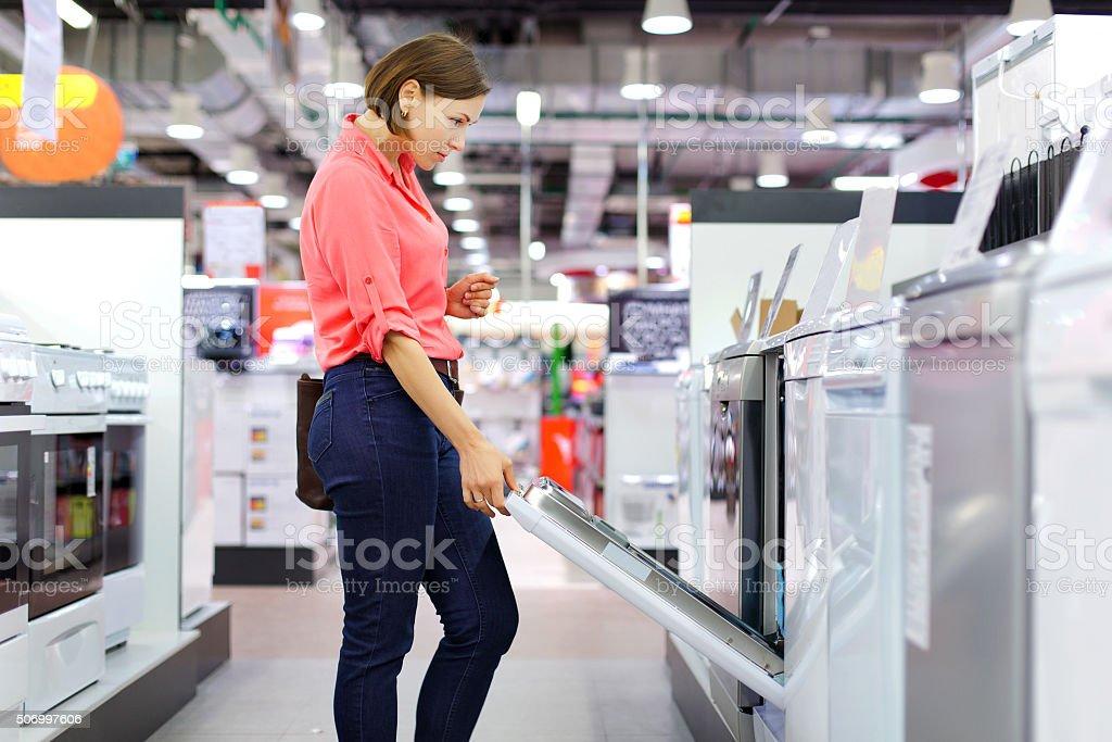 woman buys a Dishwasher woman buys a Dishwasher Adult Stock Photo