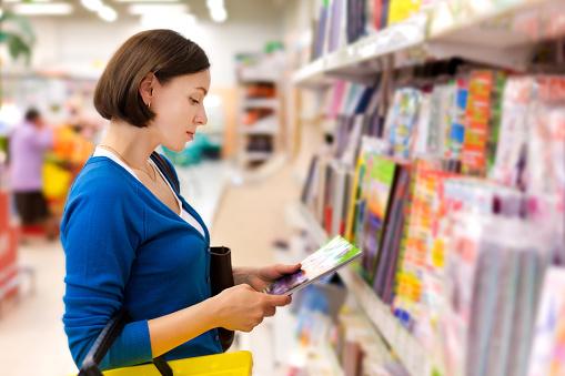 woman buys a magazine