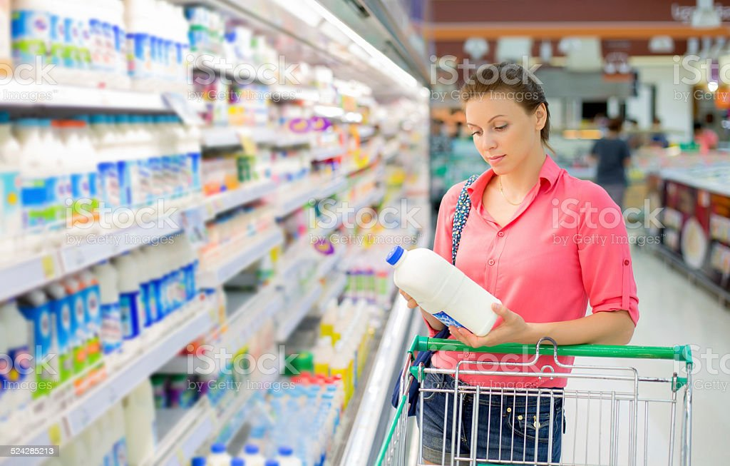 woman buys a milk stock photo