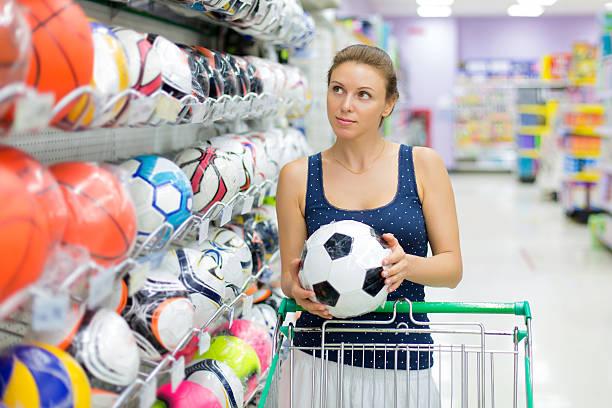 woman buys a soccer ball stock photo