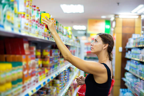 woman buys canned stock photo