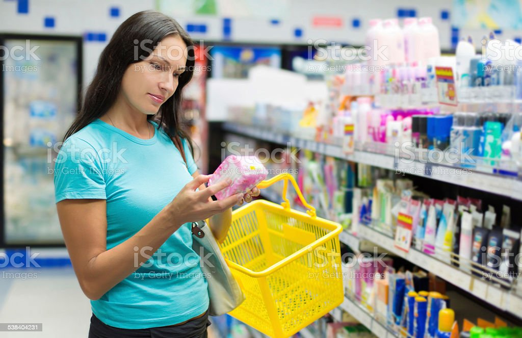 woman buys hygiene protection stock photo
