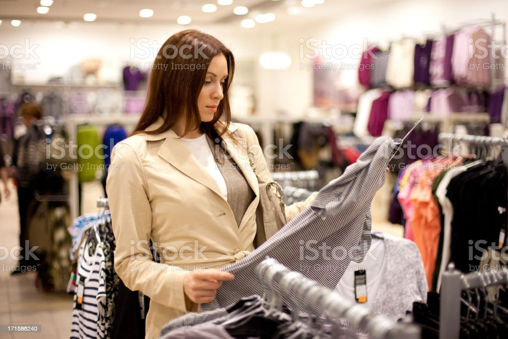 woman buys in shop royalty-free stock photo