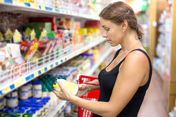 woman buys mines in the supermarket stock photo