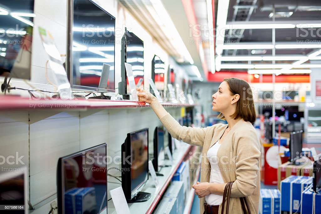 woman buys the TV stock photo