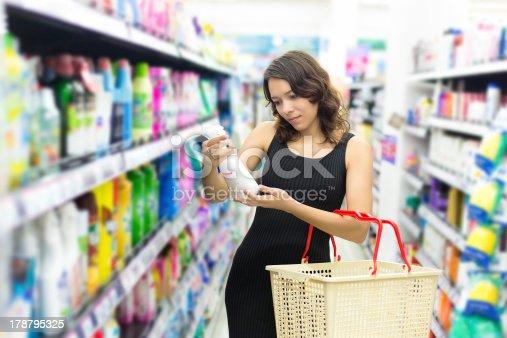 istock Woman buys washing powder 178795325