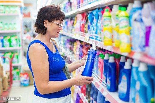 istock Woman buys washing powder 514340193