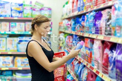 istock Woman buys washing powder 516373333