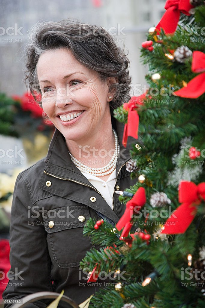 Woman by christmas tree royalty-free stock photo