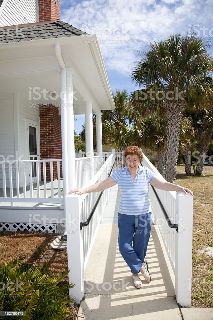 Woman by house stock photo