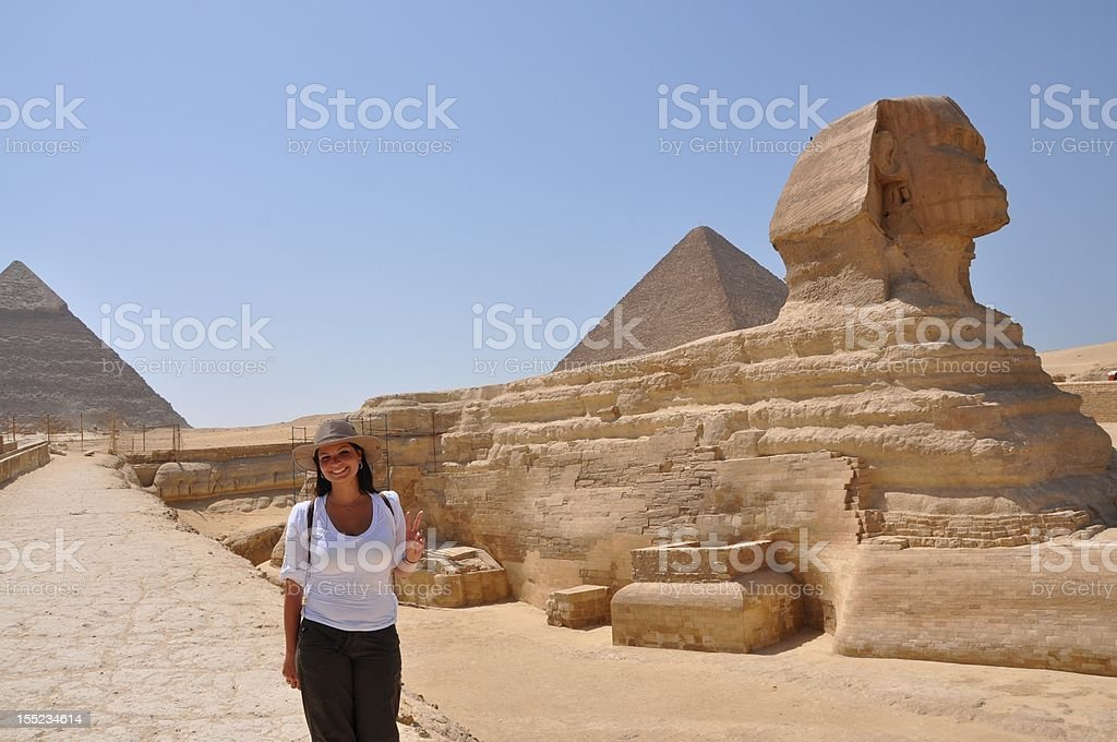 woman by sphynx stock photo