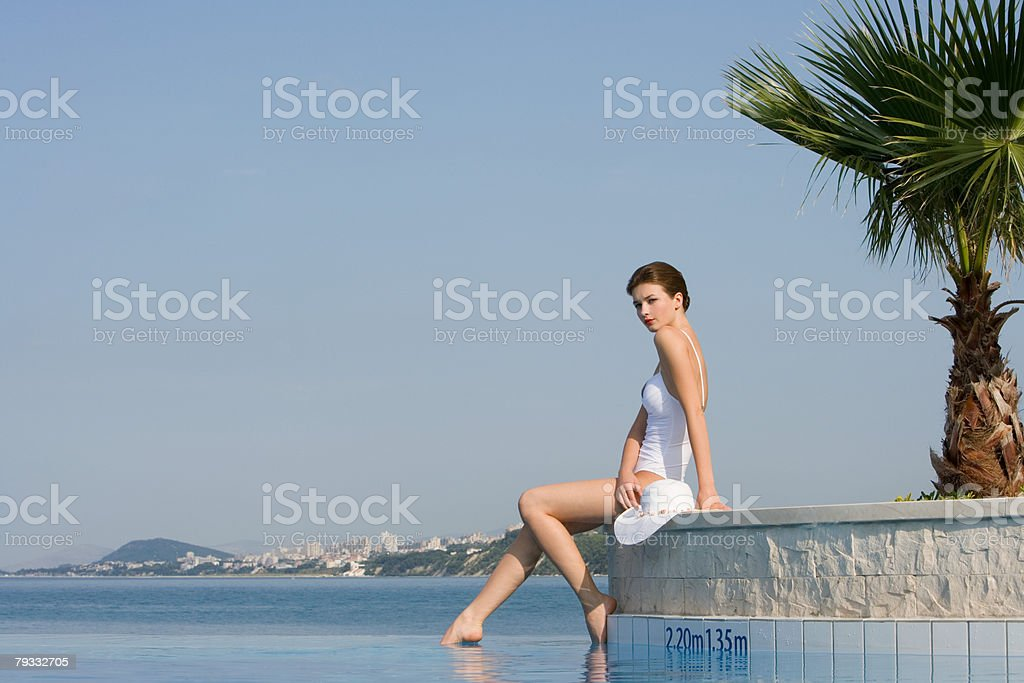 Woman by swimming pool royalty-free 스톡 사진