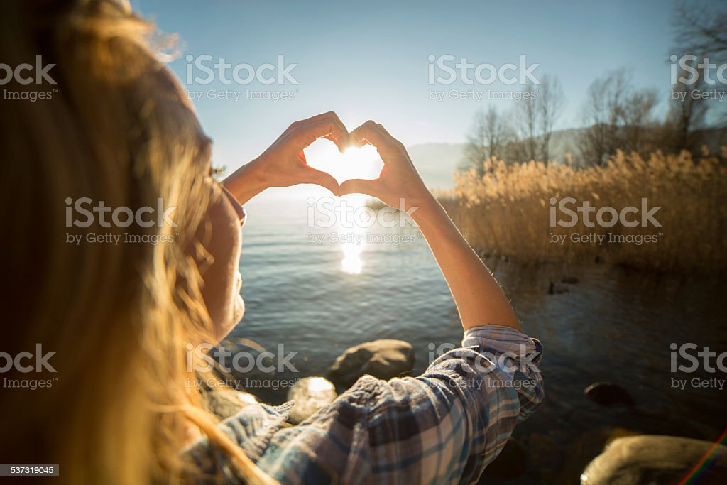 Woman By The Lake Making Heart Symbol With Hands Stock Photo More
