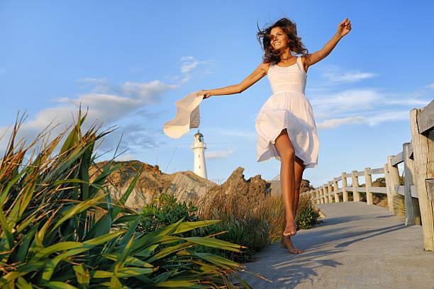 woman by the lighthouse, new zealand - beyaz elbise stok fotoğraflar ve resimler