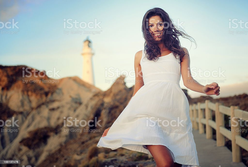 Woman by the Lighthouse (XXXL) royalty-free stock photo