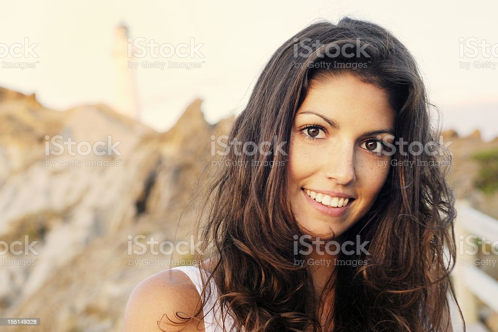 Woman by the Lighthouse (XXXL) stock photo