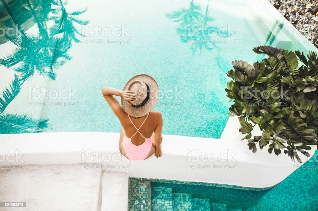 Woman by the pool stock photo
