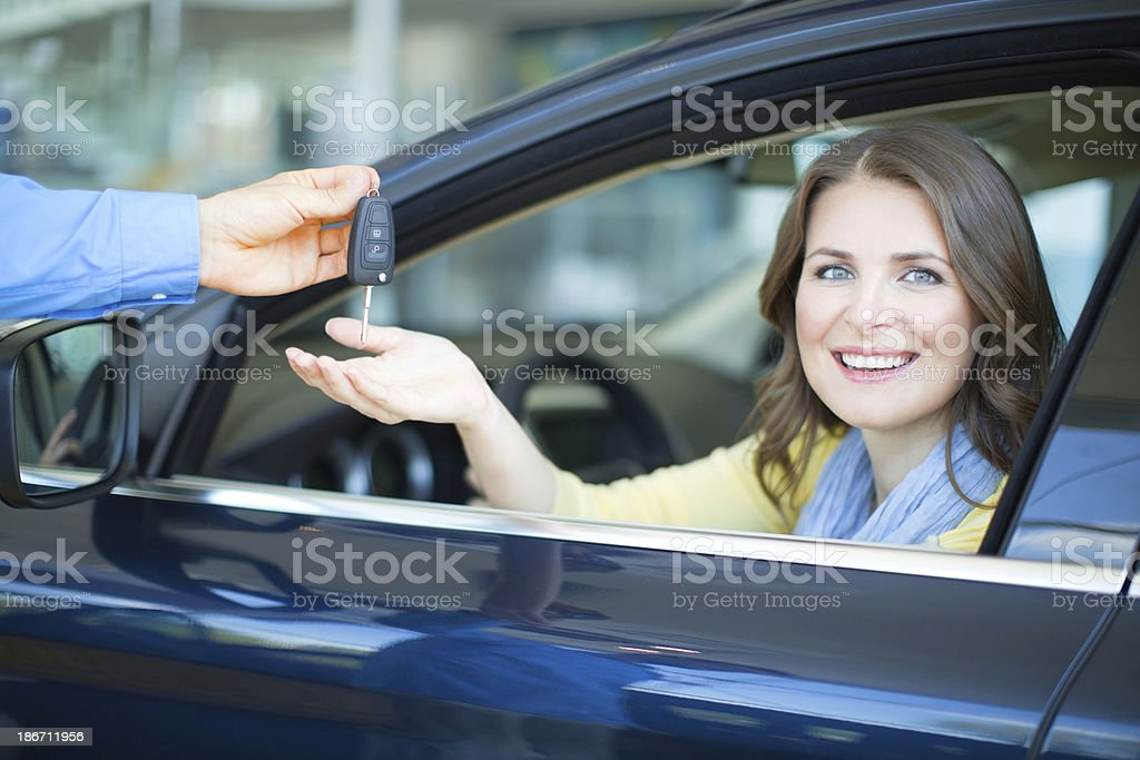 Woman bying car. royalty-free stock photo