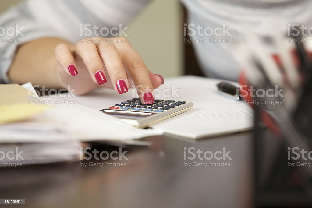Woman calculating stock photo