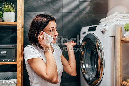 istock Woman calling for appliance repair service 941702146