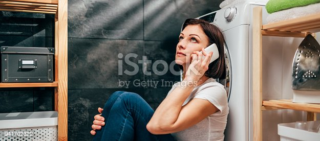 istock Woman calling for appliance repair service 941702322