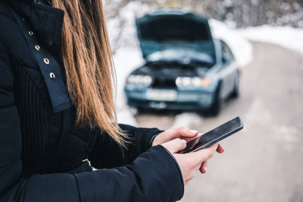 woman calling for help, her car broke! - impaired driving stock photos and pictures