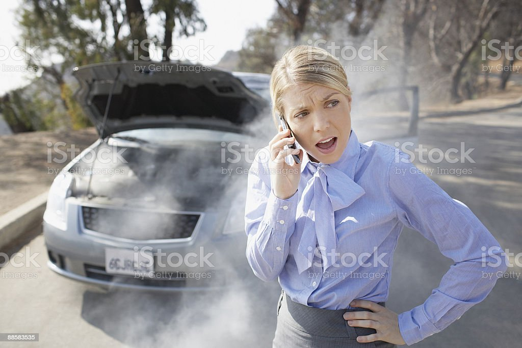 Woman calling for roadside assistance royalty-free stock photo