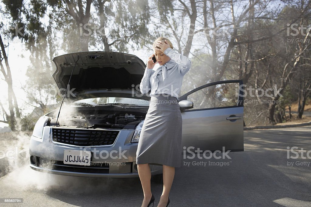 Woman calling for roadside assistance stock photo