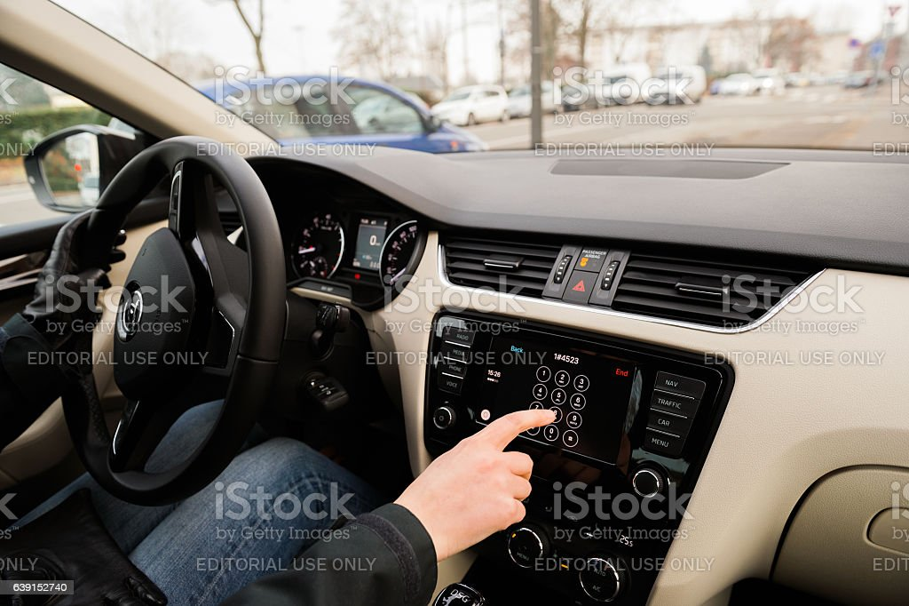 Woman calling from Car Play Apple Car dashboard stock photo