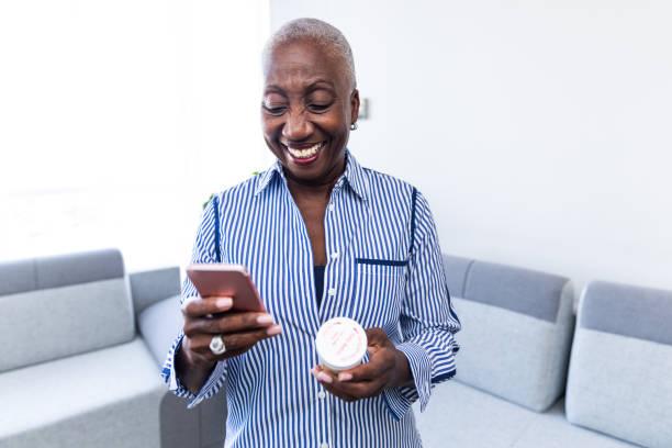 Woman Calling Her Pharmacist stock photo