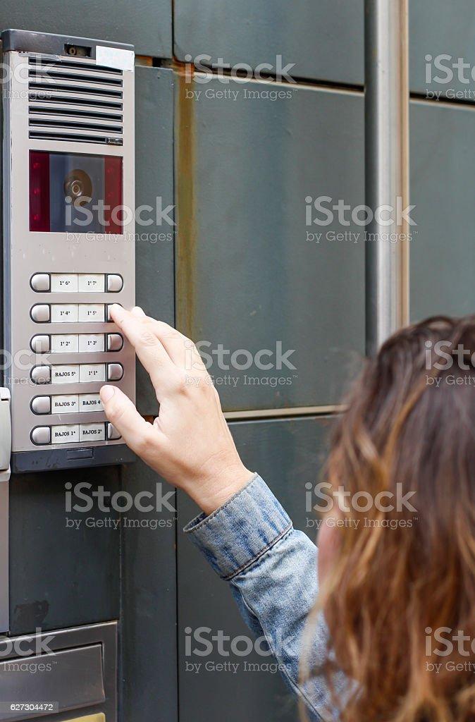 Woman  calling on the intercom stock photo
