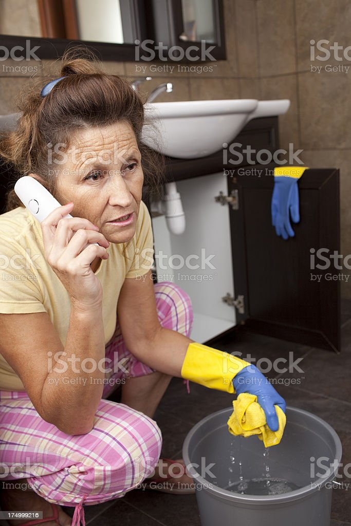 Woman calling to plumbing service. royalty-free stock photo