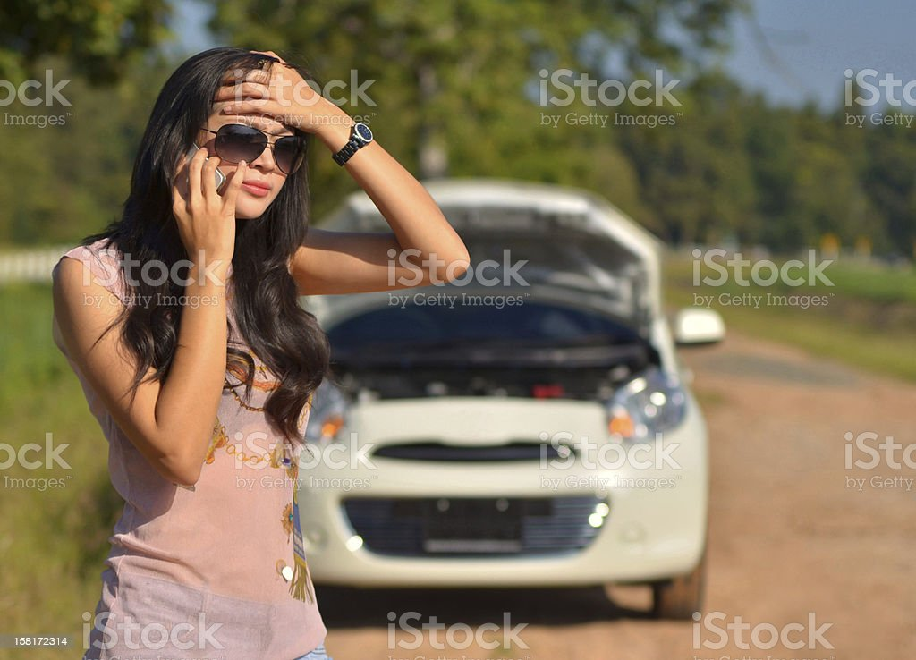 woman calls for assistance stock photo