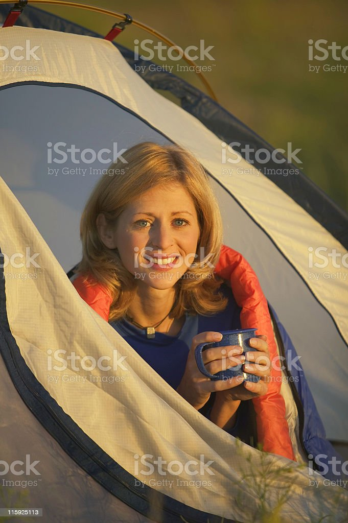 Woman Camping in Tent royalty-free stock photo
