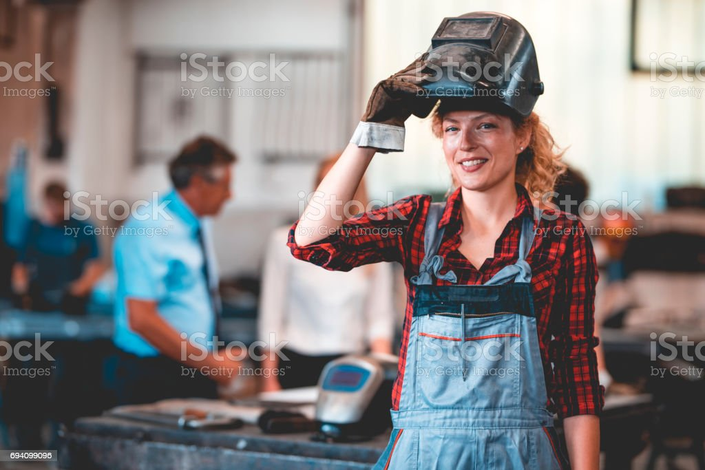 Woman can be welder too stock photo