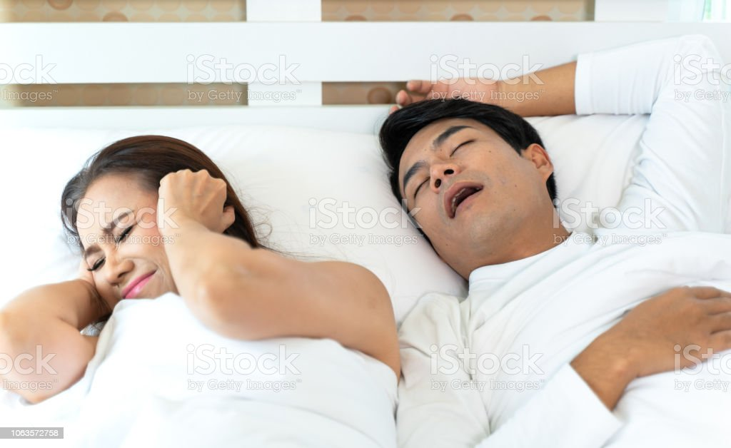 Woman Can Not Sleep While Man Snoring Stock Photo Download Image Now Istock