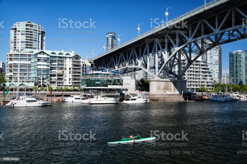 Woman canoeing at False Creek,Vancouver stock photo