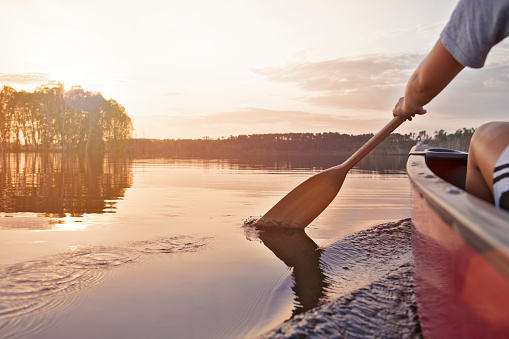 Woman canoeing at sunset