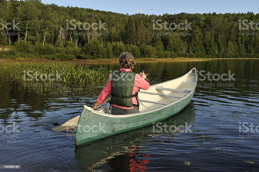 Woman canoeing on lake royalty-free stock photo