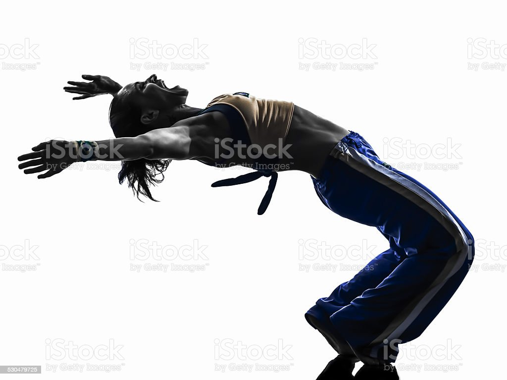 woman capoeira dancer dancing silhouette stock photo
