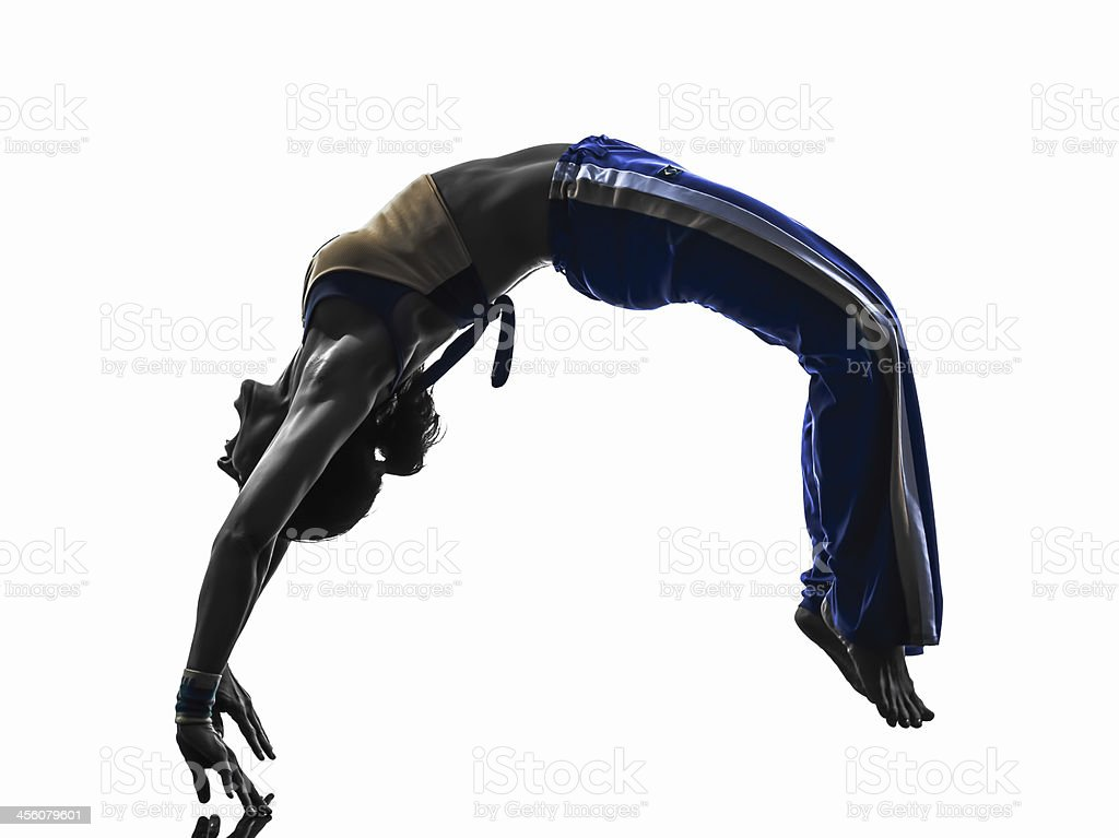 woman capoiera backflip dancer dancing silhouette stock photo