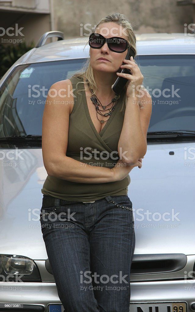 Woman, Car and Cell Phone royalty-free stock photo