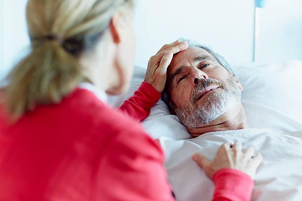 Woman caressing ill man in hospital ward picture id493216257?b=1&k=6&m=493216257&s=612x612&w=0&h=bterepsanoxb2ml8fufkmd7buxufpve8dbyggzjfzta=