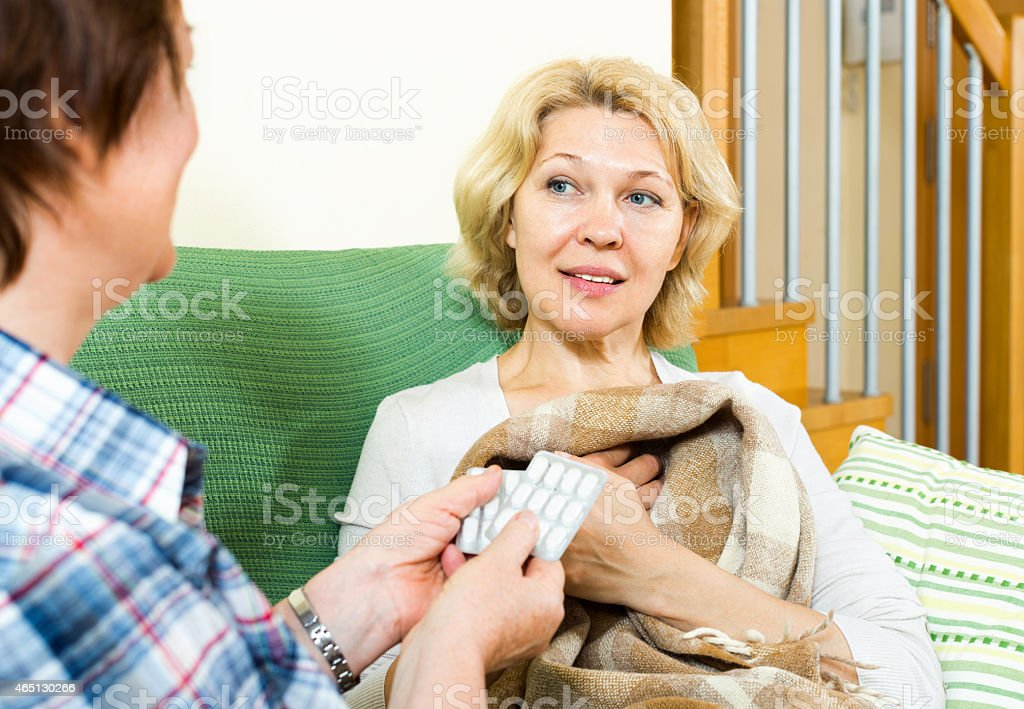 woman caring for her friend stock photo