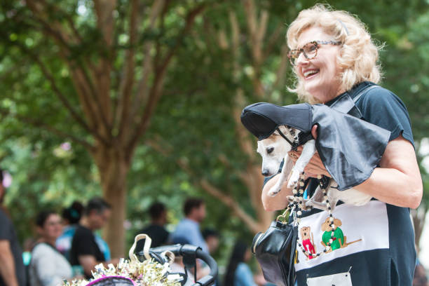 Woman carries dog wearing darth vader costume at doggy con picture id1093776246?b=1&k=6&m=1093776246&s=612x612&w=0&h=q56gwvmxriaynfzzvlxe6snnrsanypbmpw2mh6gswfk=