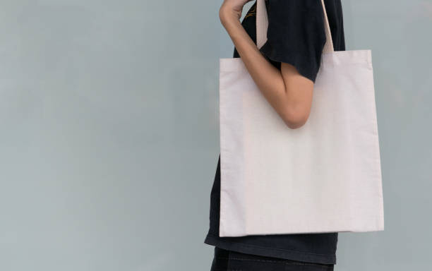 woman carry bag on nature background in save earth concept or say no plastic bag. - tote bag imagens e fotografias de stock