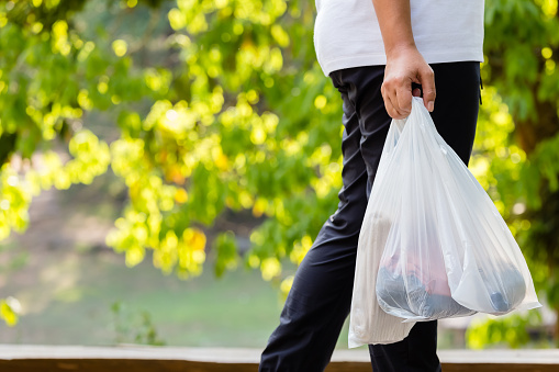 Woman Carry Plastic Bags