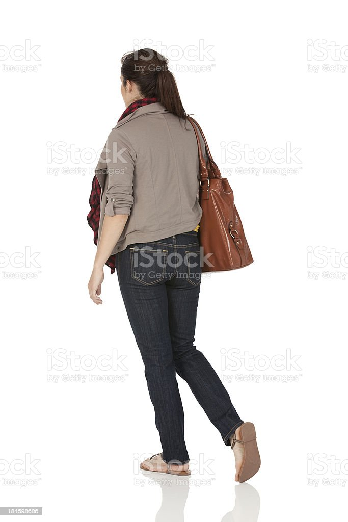 Woman carrying a leather bag stock photo