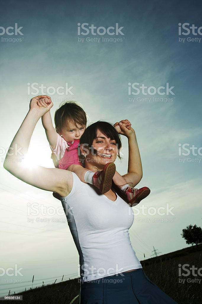 Woman carrying baby royalty-free stock photo